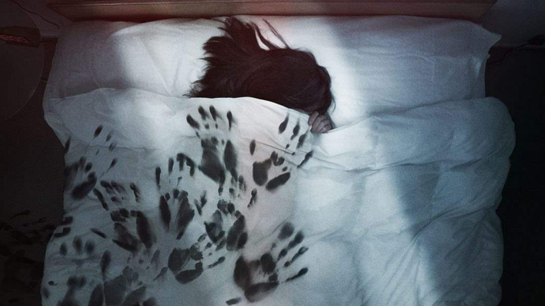 The Darkness poster image of black handprints on a bed