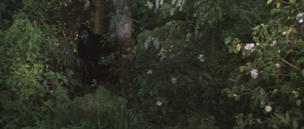 Ghostface hiding in bushes