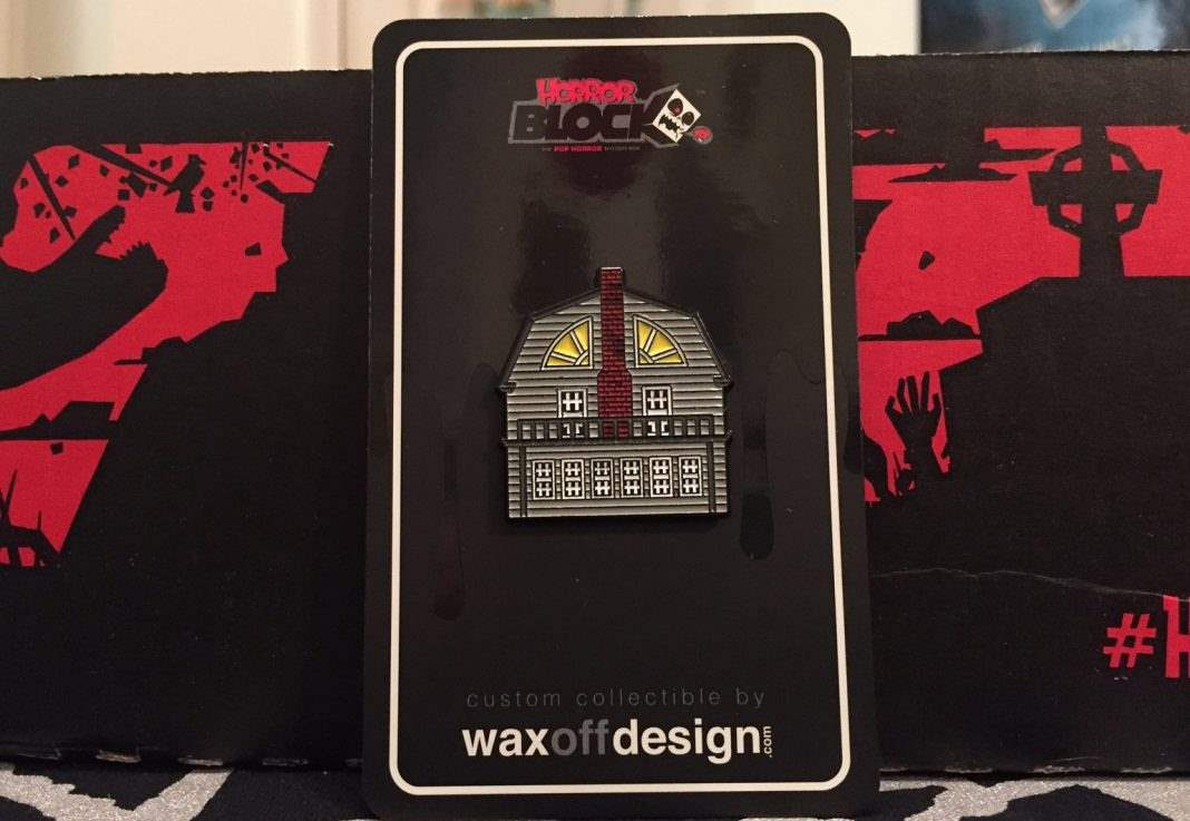 A pin feature the house from The Amityville Horror in the February 2017 Horror Block