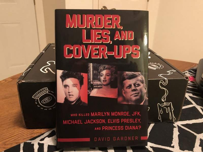Murder, Lies, and Cover-ups book in the December 2018 Creepy Crate