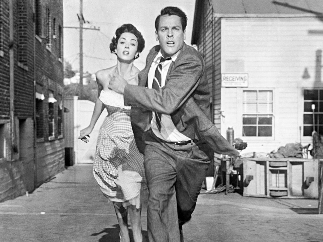Miles and Becky running down a street