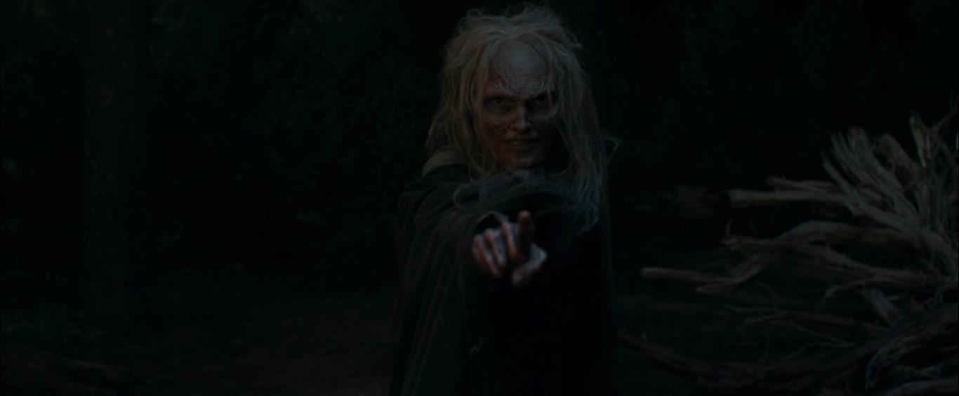 A witch zombie pointing
