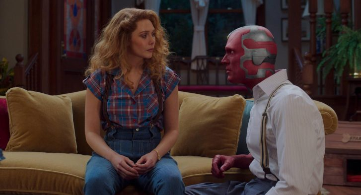 Wanda and Vision talking on the couch