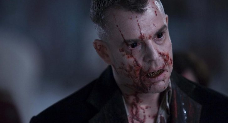 The head vampire with blood all over his face